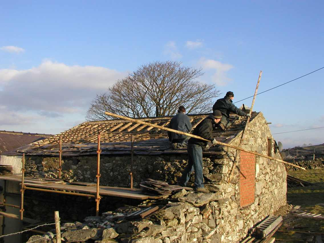 Removing the roof from the old cowshed