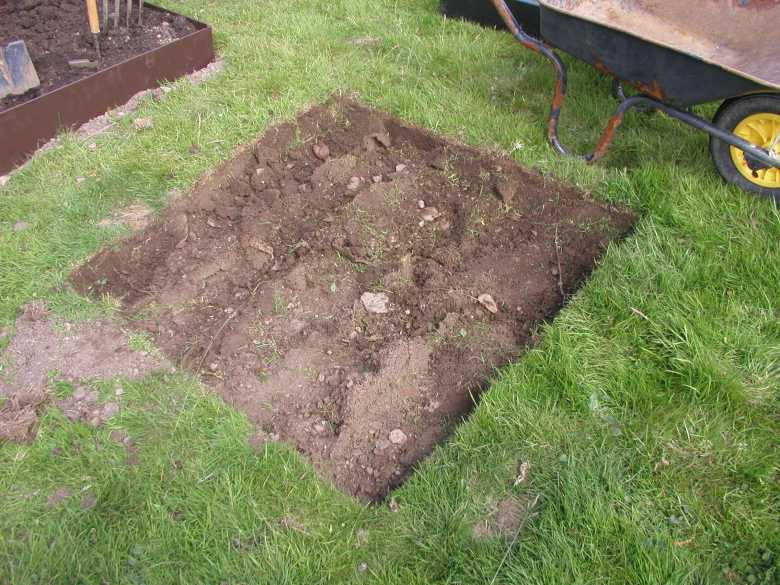 turf stripped from raised bed