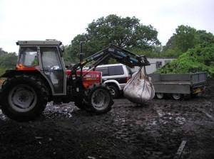 Loading Bags of Compost onto Trailer
