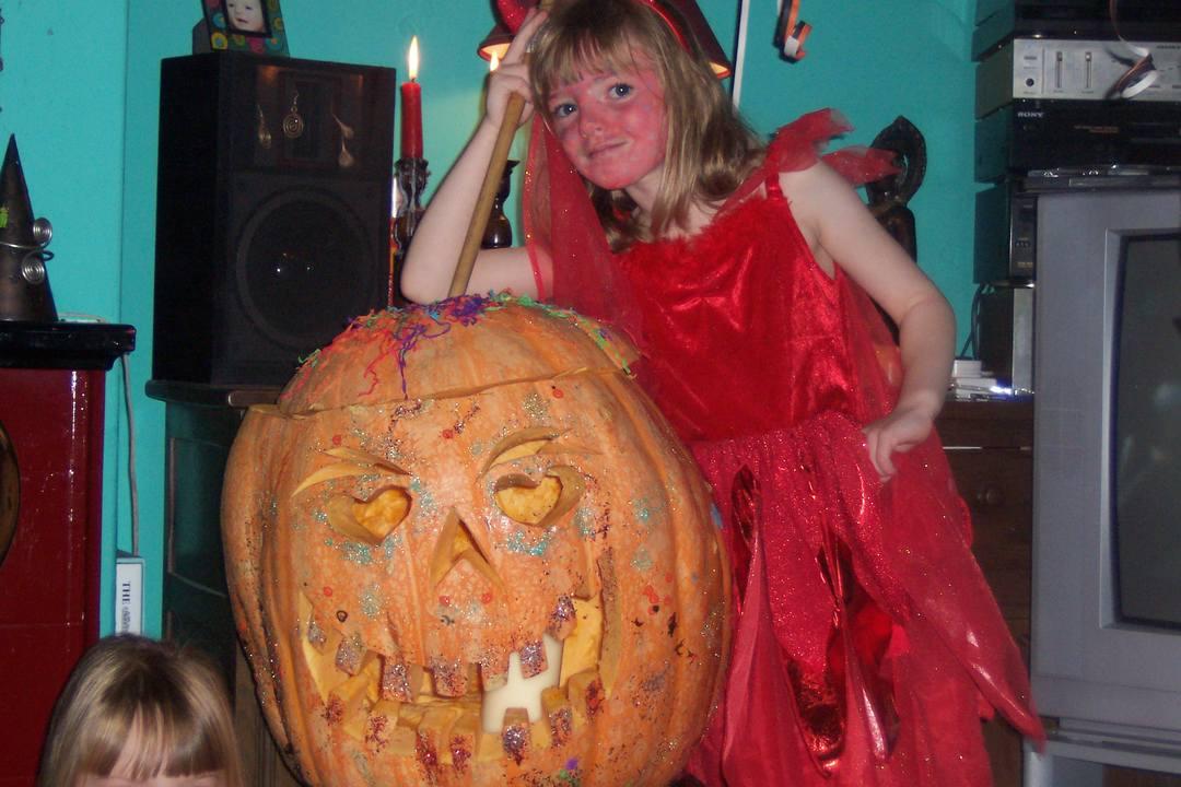 Pumpkin and Girl dressed as Devil