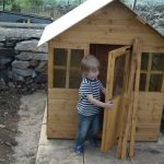 Grandson Inspects Playhouse Door