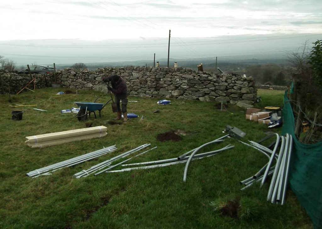 Putting the support posts in for polytunnel