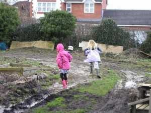 Children Playing on the Allotment in the Rain